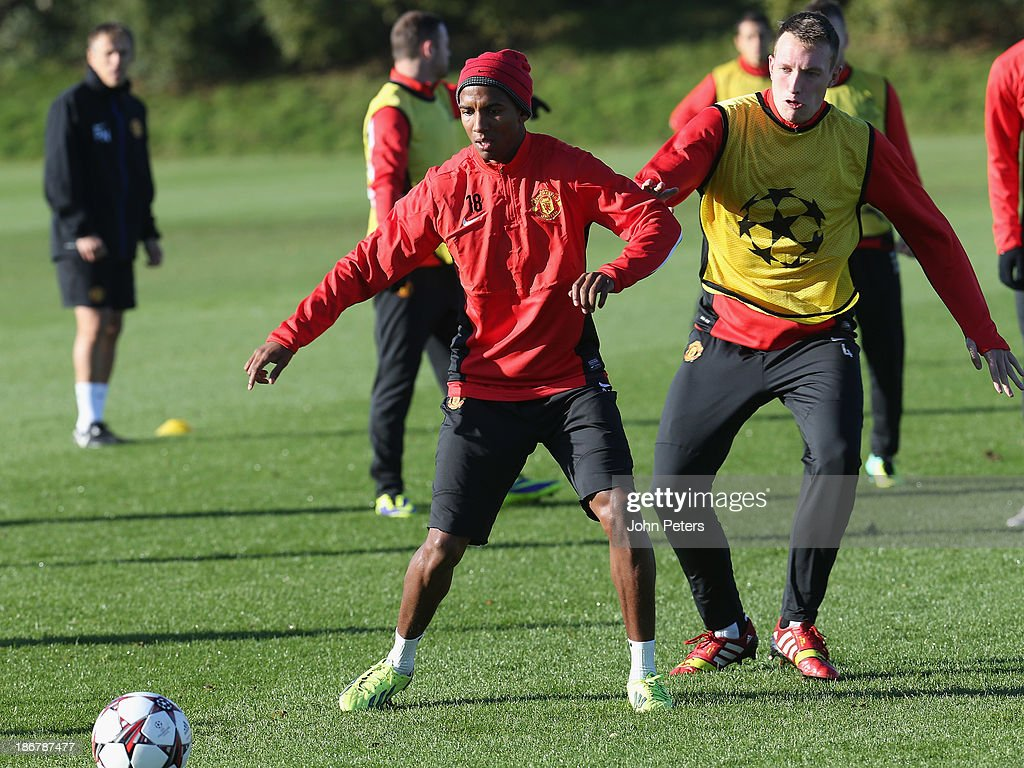 Ashley Young and Phil Jones of Manchester United in action during a first team training session, ahead of their UEFA Champions League Group A match against Real Sociedad, at the Aon Training Complex on November 4, 2013 in Manchester, England.