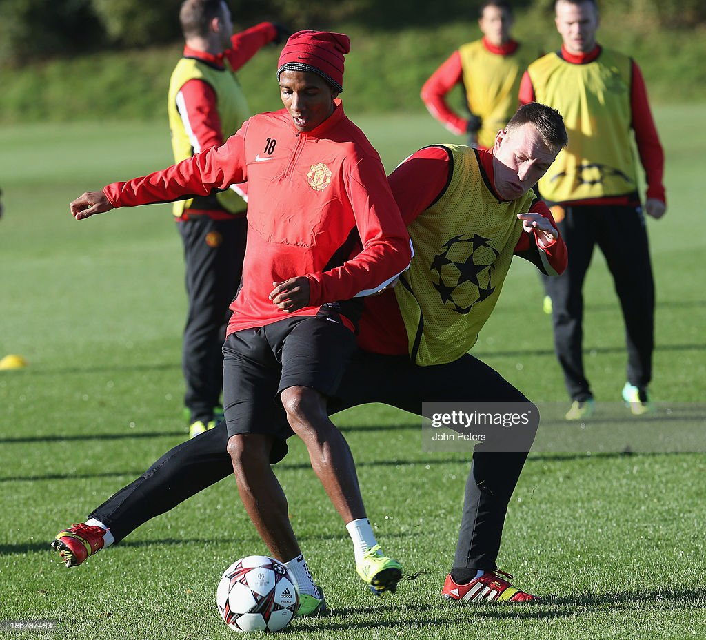 <a gi-track='captionPersonalityLinkClicked' href=/galleries/search?phrase=Ashley+Young&family=editorial&specificpeople=623155 ng-click='$event.stopPropagation()'>Ashley Young</a> and Phil Jones of Manchester United in action during a first team training session, ahead of their UEFA Champions League Group A match against Real Sociedad, at the Aon Training Complex on November 4, 2013 in Manchester, England.