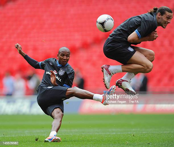 Ashley Young hits a shot into Andy Carroll during a England training session at Wembley Stadium on June 1 2012 in London England