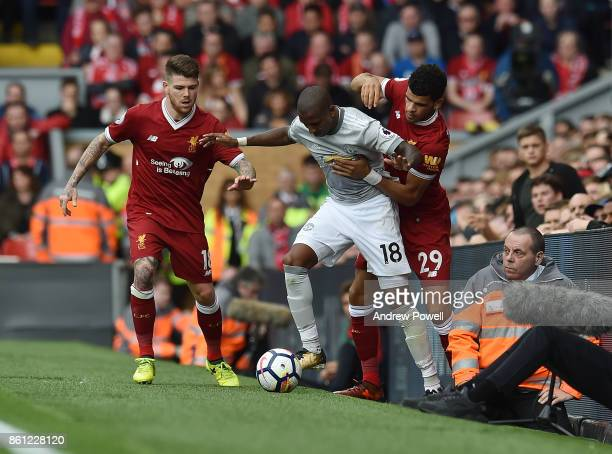 Ashley Young Manchester United stops Alberto Moreno and Dominic Solanke of Liverpool getting the ball during the Premier League match between...
