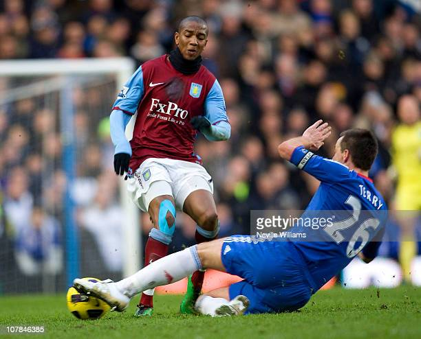 Ashley Young of Aston Villa battles for the ball with John Terry of Chelsea during the Barclays Premier League match between Chelsea and Aston Villa...