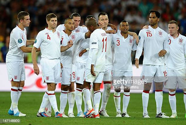 Ashley Young of England is consoled after missing his penalty during the UEFA EURO 2012 quarter final match between England and Italy at The Olympic...