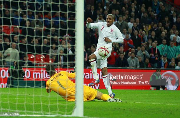 Ashley Young of England scores his team's second and equalising goal against goalkeeper Maarten Stekelenburg of Netherlands during the International...