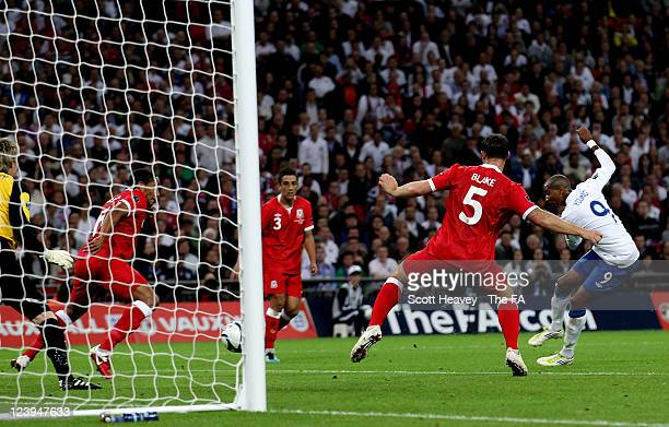 Ashley Young of England scoreshis team's first goal during the UEFA EURO 2012 Group G Qualifying match between England and Wales at Wembley Stadium...