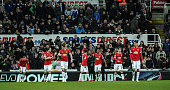 Ashley Young of Manchester celebrates with teammates Wayne Rooney Daley Blind Michael Carrick Juan Mata Ander Herrera and Chris Smalling after...