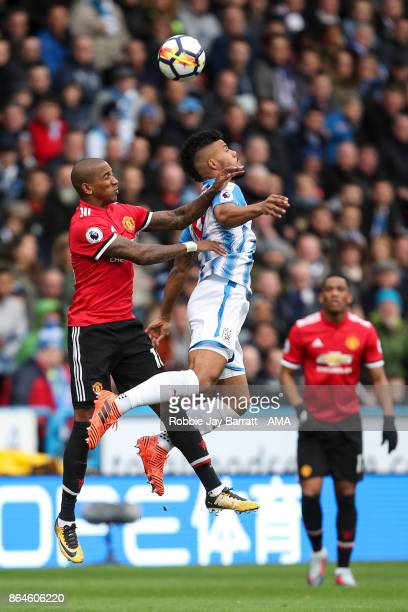 Ashley Young of Manchester United and Elias Kachunga of Huddersfield Town during the Premier League match between Huddersfield Town and Manchester...