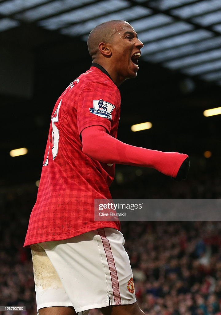 Ashley Young of Manchester United celebrates after Gareth McAuley of West Bromwich Albion scored an own goal to make the score 1-0 during the Barclays Premier League match between Manchester United and West Bromwich Albion at Old Trafford on December 29, 2012 in Manchester, England.