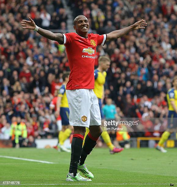 Ashley Young of Manchester United celebrates Ander Herrera scoring their first goal during the Barclays Premier League match between Manchester...