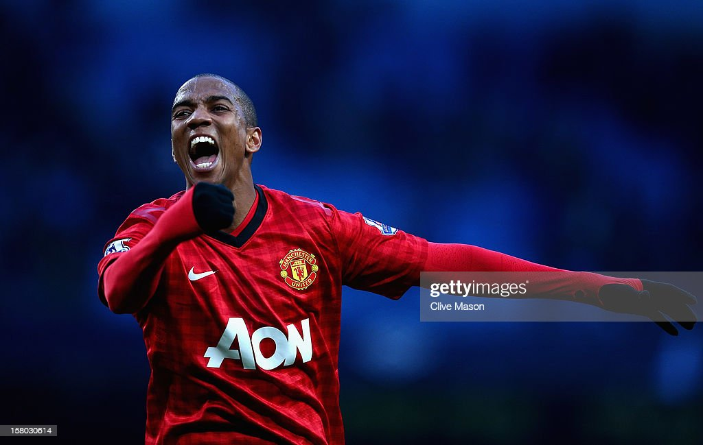 Ashley Young of Manchester United celebrates at the end of during the Barclays Premier League match between Manchester City and Manchester United at Etihad Stadium on December 9, 2012 in Manchester, England.
