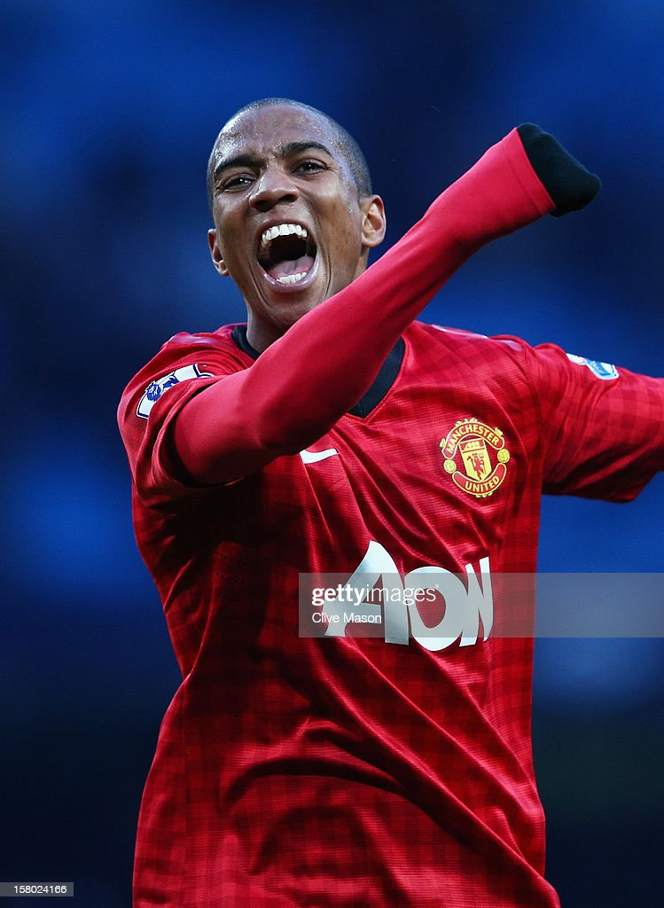 Ashley Young of Manchester United celebrates at the end of the Barclays Premier League match between Manchester City and Manchester United at the Etihad Stadium on December 9, 2012 in Manchester, England.