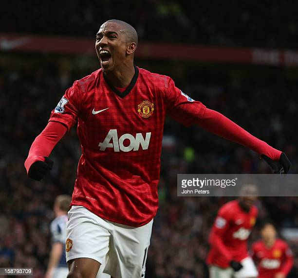 Ashley Young of Manchester United celebrates his part in Gareth McAuley of West Bromwich Albion scoring an owngoal during the Barclays Premier League...