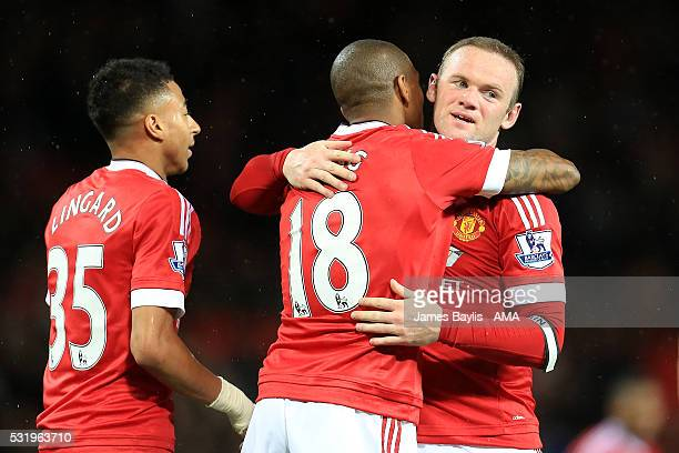 Ashley Young of Manchester United celebrates scoring a goal to make the score 30 with teammate Wayne Rooney during the Barclays Premier League match...
