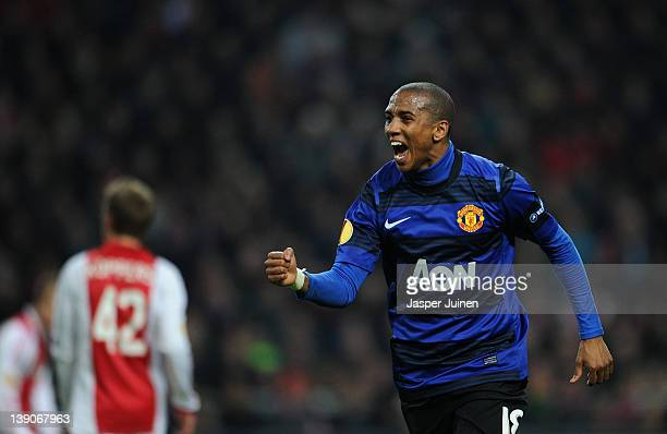 Ashley Young of Manchester United celebrates scoring his sides opening goal during the UEFA Europa League round of 32 first leg match between Ajax...