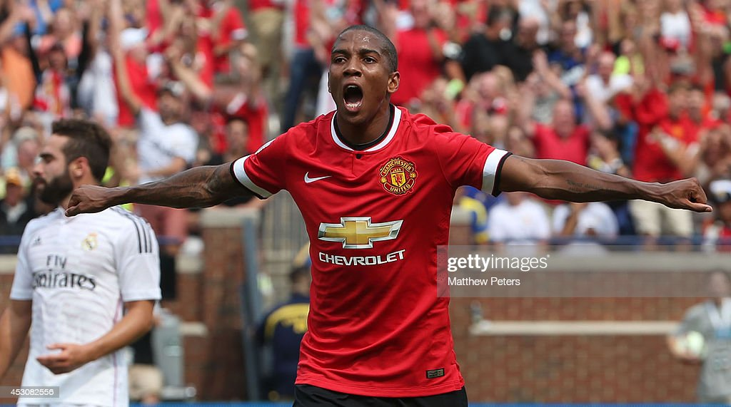<a gi-track='captionPersonalityLinkClicked' href=/galleries/search?phrase=Ashley+Young&family=editorial&specificpeople=623155 ng-click='$event.stopPropagation()'>Ashley Young</a> of Manchester United celebrates scoring the first goal during the pre-season friendly match between Manchester United and Real Madrid at Michigan Stadium on August 2, 2014 in Ann Arbor, Michigan.