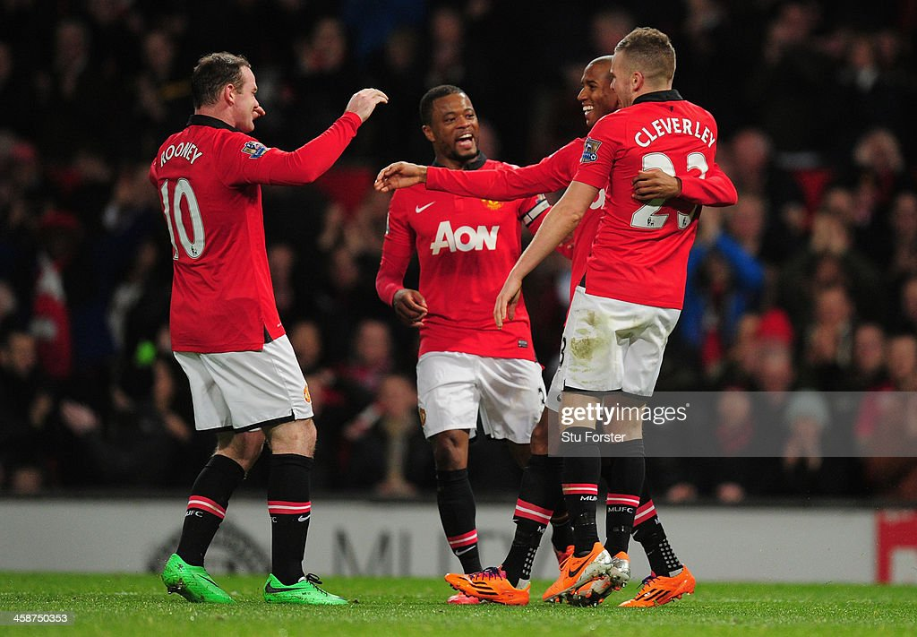 <a gi-track='captionPersonalityLinkClicked' href=/galleries/search?phrase=Ashley+Young&family=editorial&specificpeople=623155 ng-click='$event.stopPropagation()'>Ashley Young</a> of Manchester United celebrates scoring the third goal with his team-mates during the Barclays Premier League match between Manchester United and West Ham United at Old Trafford on December 21, 2013 in Manchester, England.