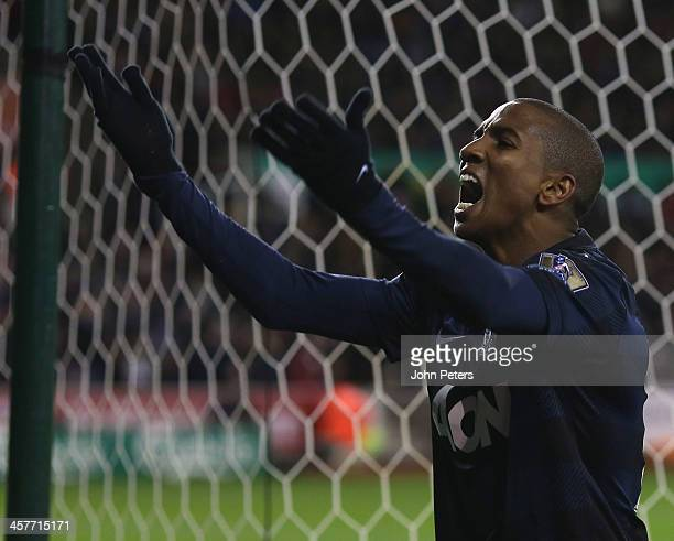 Ashley Young of Manchester United celebrates scoring their first goal during the Capital One Cup Fifth Round match between Stoke City and Manchester...