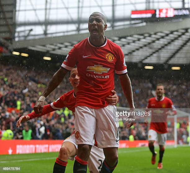 Ashley Young of Manchester United celebrates scoring their first goal during the Barclays Premier League match between Manchester United and...