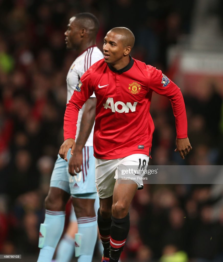 <a gi-track='captionPersonalityLinkClicked' href=/galleries/search?phrase=Ashley+Young&family=editorial&specificpeople=623155 ng-click='$event.stopPropagation()'>Ashley Young</a> of Manchester United celebrates scoring their third goal during the Barclays Premier League match between Manchester United and West Ham United at Old Trafford on December 21, 2013 in Manchester, England.
