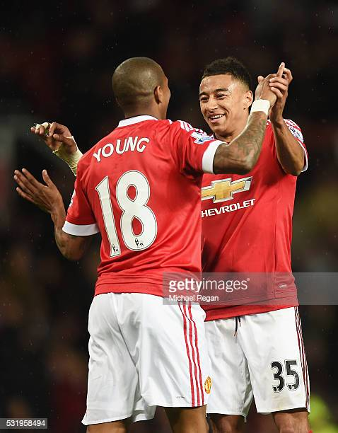 Ashley Young of Manchester United celebrates with Jesse Lingard as he scores their third goal during the Barclays Premier League match between...