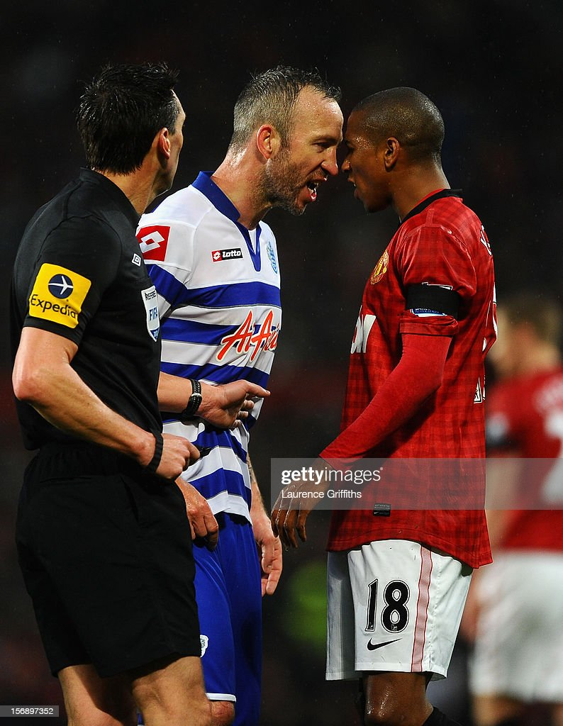 Ashley Young of Manchester United goes head to head with Shaun Derry of Queens Park Rangers during the Barclays Premier League match between Manchester United and Queens Park Rangers at Old Trafford on November 24, 2012 in Manchester, England.