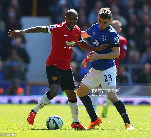 Ashley Young of Manchester United holds off Seamus Coleman of Everton during the Barclays Premier League match between Everton and Manchester United...