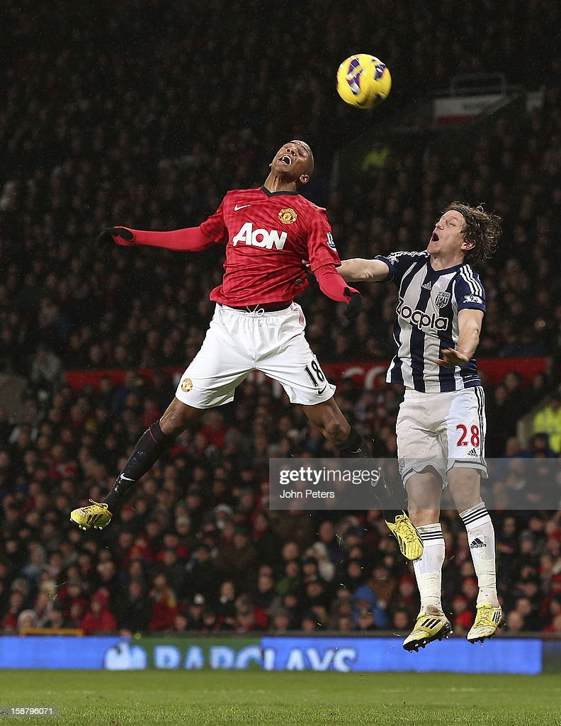 Ashley Young of Manchester United in action with Billy Jones of West Bromwich Albion during the Barclays Premier League match between Manchester United and West Bromwich Albion at Old Trafford on December 29, 2012 in Manchester, England.