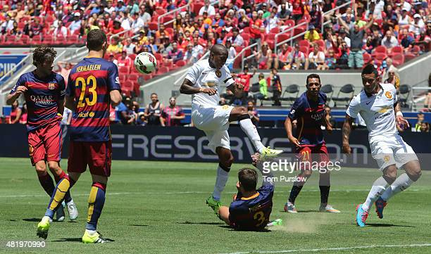 Ashley Young of Manchester United in action with Gerard Pique of Barcelona during the International Champions Cup 2015 match between Manchester...