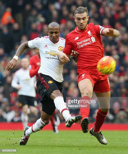 Ashley Young of Manchester United in action with Jordan Henderson of Liverpool during the Barclays Premier League match between Liverpool and...