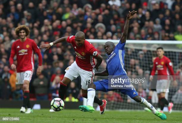 Ashley Young of Manchester United in action with Ngolo Kante of Chelsea during the Premier League match between Manchester United and Chelsea at Old...