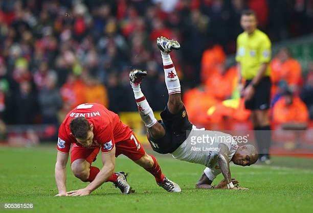 Ashley Young of Manchester United is challenged by James Milner of Liverpool during the Barclays Premier League match between Liverpool and...