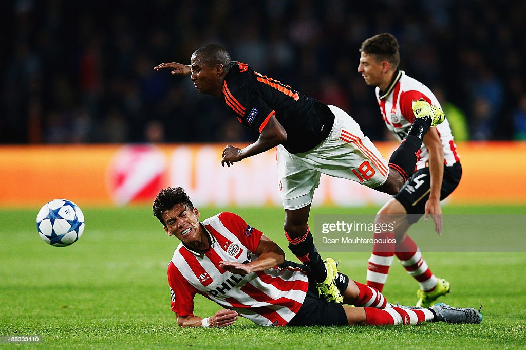 Ashley Young of Manchester United is fouled by Hector Moreno of PSV Eindhoven during the UEFA Champions League Group B match between PSV Eindhoven and Manchester United at PSV Stadion on September 15, 2015 in Eindhoven, Netherlands.