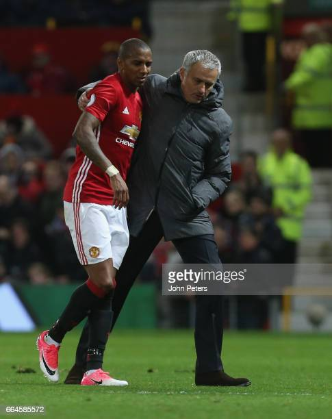 Ashley Young of Manchester United is helped off the pitch by Manager Jose Mourinho during the Premier League match between Manchester United and...