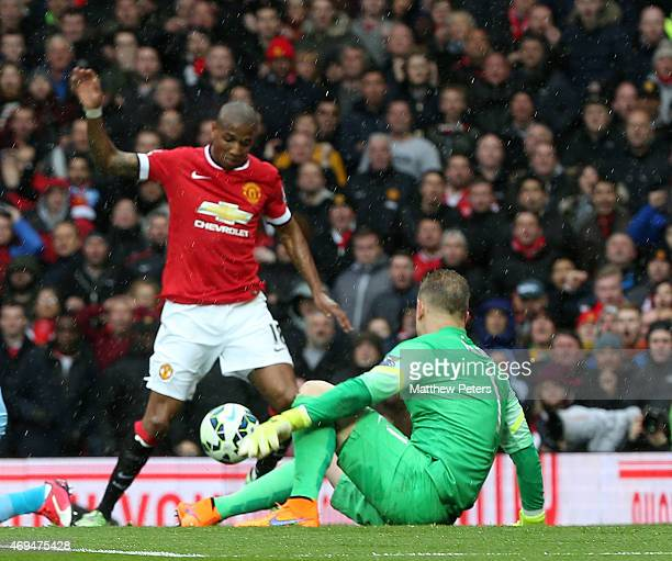 Ashley Young of Manchester United scores their first goal during the Barclays Premier League match between Manchester United and Manchester City at...