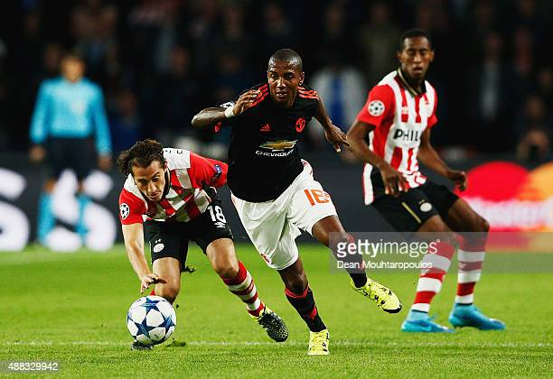 Ashley Young of Manchester United takes the ball away from Andres Guardado of PSV Eindhoven during the UEFA Champions League Group B match between...