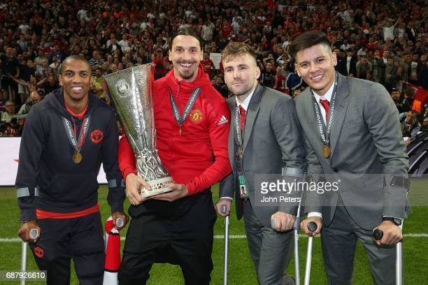 Ashley Young Zlatan Ibrahimovic Luke Shaw and Marcos Rojo of Manchester United celebrate with the Europa League trophy after the UEFA Europa League...