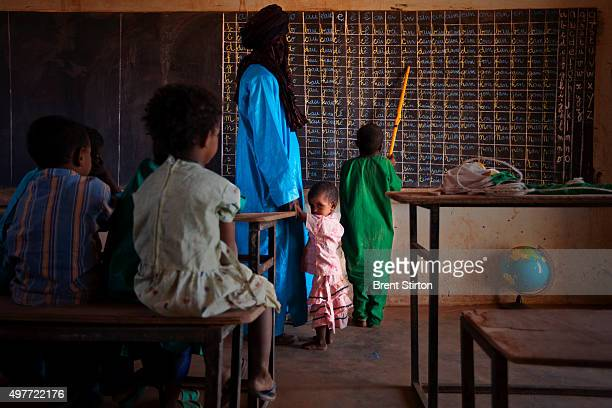 Ashmoudou Assalek teaches in a nomad school in the impoverished Tuareg village of Assaouas on October 9 2009 in Ingal Niger Assalek teaches 4...