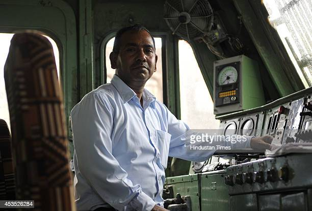Ashok Kumar loco pilot of Indore bound Double Decker AC Express on last day of its run on August 12 2014 in Bhopal India Operation of...