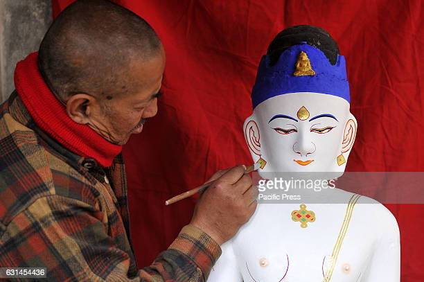 JAN BAHAL KATHMANDU NEPAL KATHMANDU NE NEPAL Ashok Muni Bajracharya 55yrs old a priest decorates the idol Seto Machhendranath at Jan Bahal Seto...