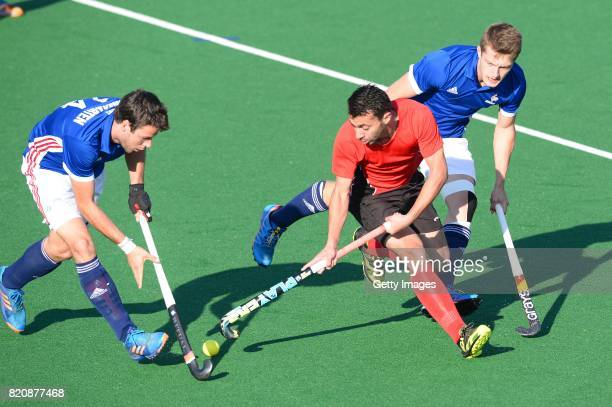 Ashraf Said of Egypt tackled by Gaspard Baumgarten of France during day 8 of the FIH Hockey World League Men's Semi Finals 7th8th place match between...