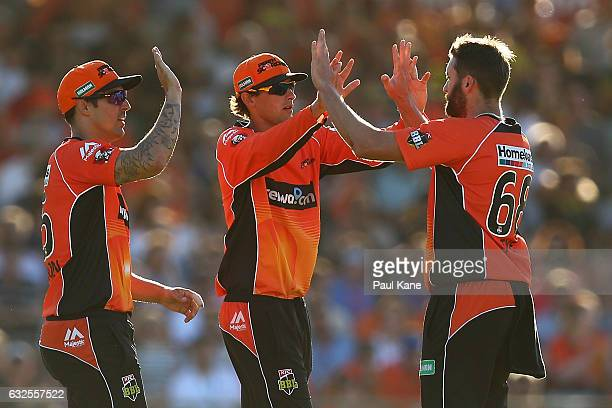 Ashton Agar and Andrew Tye of the Scorchers celebrate after dismissing Ben Hilfenhaus of the Stars during the Big Bash League match between the Perth...