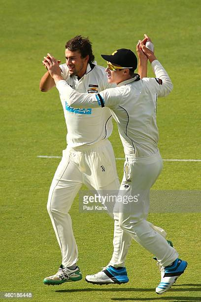 Ashton Agar and Cameron Bancroft of Western Australia celebrate the dismissal of Rob Quiney of Victoria during day one of the Sheffield Shield match...