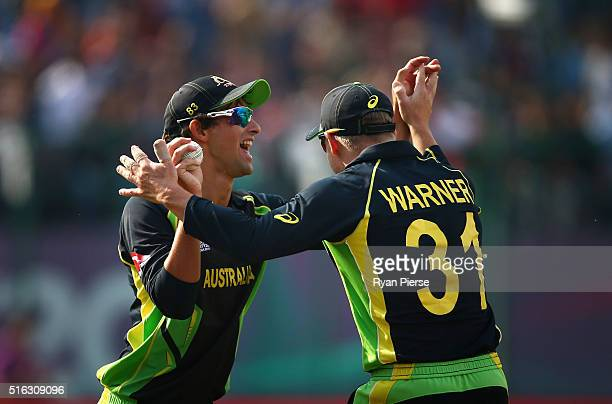 Ashton Agar and David Warner of Australia celebrates after Agar a catch to dismiss Corey Anderson of New Zealand during the ICC World Twenty20 India...