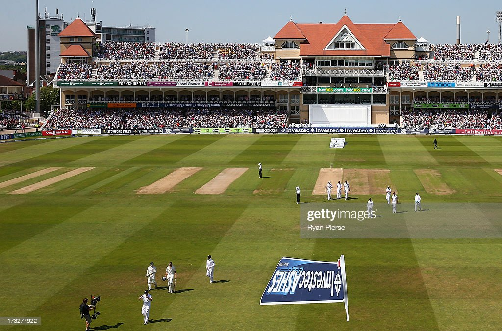 Ashton Agar and Phil Hughes of Australia leave the ground after their record 10th wicket partnership during day two of the 1st Investec Ashes Test match between England and Australia at Trent Bridge Cricket Ground on July 11, 2013 in Nottingham, England.
