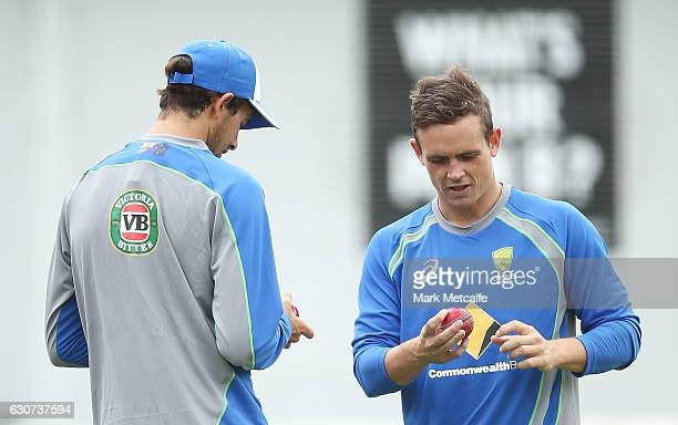 Ashton Agar and Steve O'Keefe prepare to bowl during an Australian training session on January 1 2017 in Sydney Australia