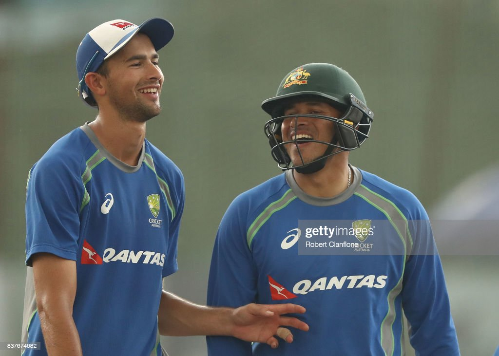 Ashton Agar and Usman Khawaja of Australia laugh during an Australian Test team nets session at Sher-E Bangla National Cricket Stadium on August 23, 2017 in Dhaka, Bangladesh.