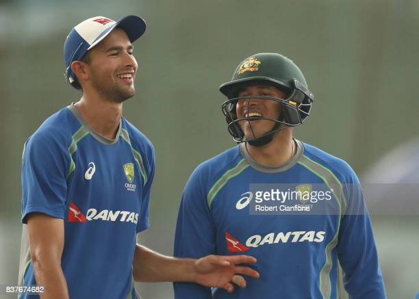 Ashton Agar and Usman Khawaja of Australia laugh during an Australian Test team nets session at SherE Bangla National Cricket Stadium on August 23...