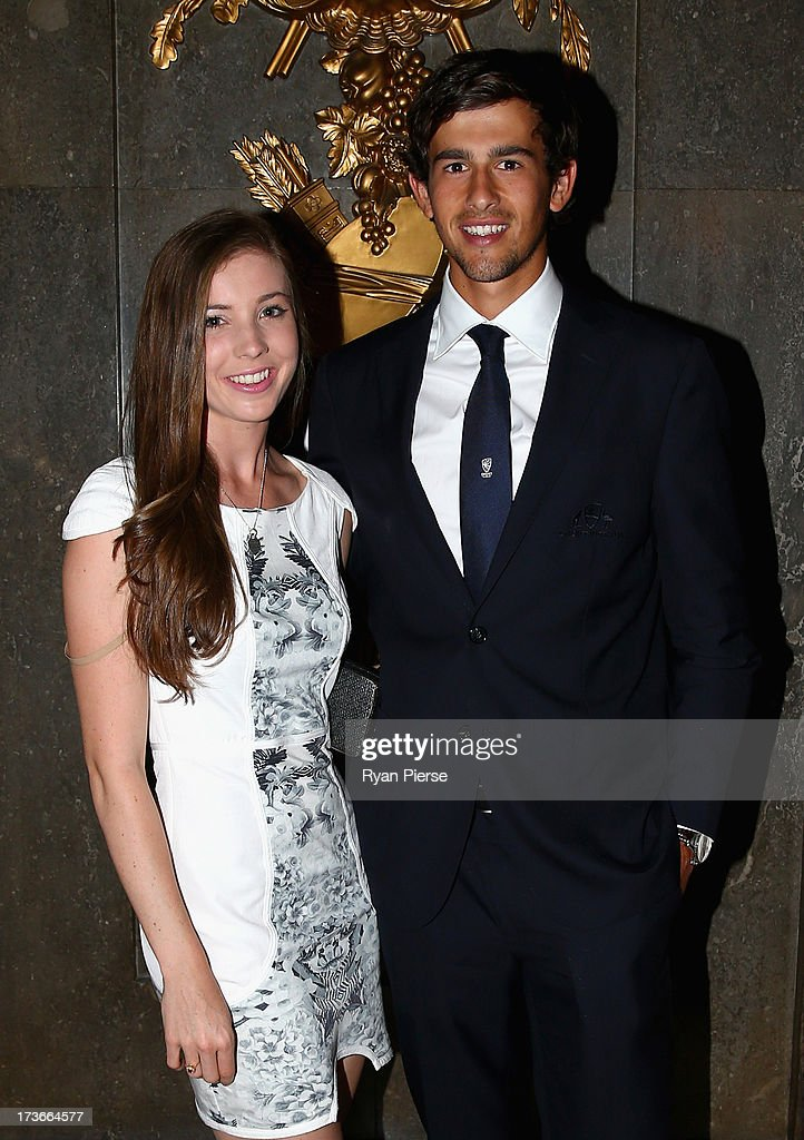 <a gi-track='captionPersonalityLinkClicked' href=/galleries/search?phrase=Ashton+Agar&family=editorial&specificpeople=9101391 ng-click='$event.stopPropagation()'>Ashton Agar</a> of Australia and his girlfriend Madi Hay pose during the Australian Cricket Team visit to the Australian High Commision on July 16, 2013 in London, England.