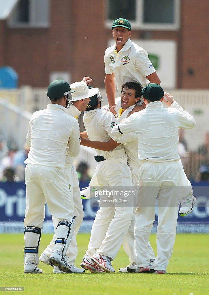 <a gi-track='captionPersonalityLinkClicked' href=/galleries/search?phrase=Ashton+Agar&family=editorial&specificpeople=9101391 ng-click='$event.stopPropagation()'>Ashton Agar</a> of Australia celebrates the wicket of Alastair Cook of England with team mates during day three of the 1st Investec Ashes Test match between England and Australia at Trent Bridge Cricket Ground on July 12, 2013 in Nottingham, England.