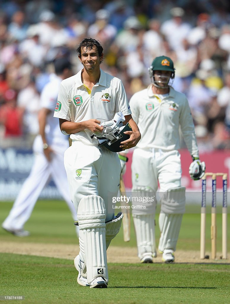 Ashton Agar of Australia walks off with Phil Hughes after being dismissed by Stuart Broad of England for 98 runs during day two of the 1st Investec Ashes Test match between England and Australia at Trent Bridge Cricket Ground on July 11, 2013 in Nottingham, England.