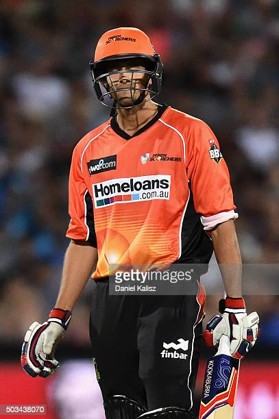 Ashton Agar of the Scorchers reacts after being struck on the arm by a delivery from Billy Stanlake of the Adelaide Strikers during the Big Bash...